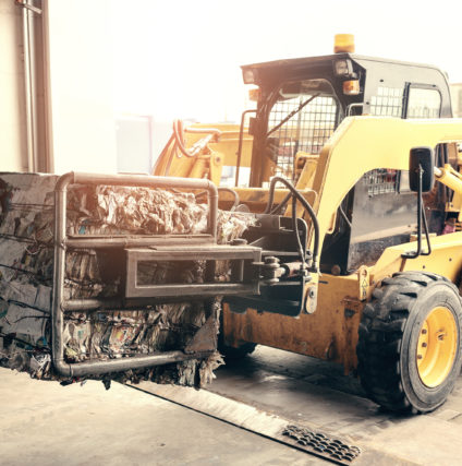Forklift truck. Waste processing plant. Technological process. Recycling and storage of waste for further disposal.